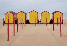 Vintage beach cabins in yellow and red, located in De Panne, Belgium Stock Photography