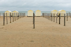 Vintage beach cabins in yellow stripes, located in De Panne, Belgium Stock Photo