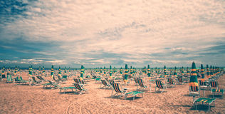 Vintage Beach With Deckchairs Royalty Free Stock Images
