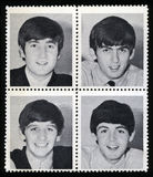 Vintage Beatles. UNITED KINGDOM - CIRCA 1963: Vintage Merchandise stamps each portraying an image of a member of `The Beatles`, circa 1963 Royalty Free Stock Photos