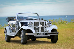 Vintage beauford wedding car. Photo of a vintage beauford wedding car on show at whitstable seafront during summer of 2015 Stock Image