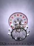 Vintage beautiful classic crystal chandelier shines. NCeiling old lamp stock photo