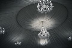 vintage beautiful crystal chandeliers on the ceiling royalty free stock photography