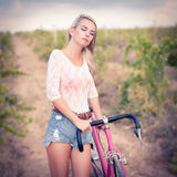 Vintage beautiful fashion girl with bicycle Stock Photo