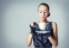 Vintage beautiful fashion girl with coffee cup Royalty Free Stock Photography
