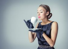 Vintage beautiful fashion girl with coffee cup. Fashion portrait of beautiful young girl with a coffee cup in classic vintage style royalty free stock photos