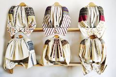 Hand sewn traditional Romanian blouses, known as `ii`. Vintage beautiful Hand sewn traditional Romanian blouses from the northern part of the country, Bucovina royalty free stock photos