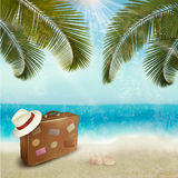 Vintage beautiful seaside background with suitcase Stock Image