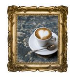 Vintage beautiful silver rectangular frame with an ornament, espresso macchiato coffee with foam heart isolated on white. Retro stock image