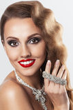 Vintage beautiful smiling woman with jewerly Royalty Free Stock Photos