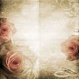 Vintage beautiful wedding background. With roses, notes  and rings  in beige and pink colours Stock Image