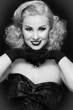 Vintage beauty. Black and white portrait of smiling happy vintage beauty with curly hair Royalty Free Stock Image
