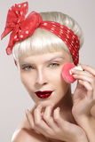 Vintage beauty model applying powder on skin closeup Royalty Free Stock Photo
