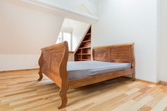 Vintage bed in the attic Royalty Free Stock Photo