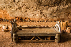 Vintage bed in cave Royalty Free Stock Images