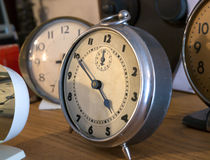 Vintage Bedroom clocks. Some old, vintage analogue clocks like you would find at bedside Royalty Free Stock Photography