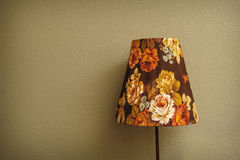 Vintage Bedroom floor lamp glowing orange in a corner of a room Stock Photos