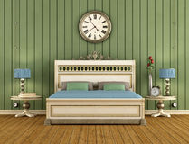 Vintage Bedroom with green wall paneling Stock Image