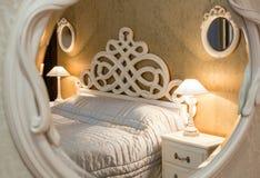 Vintage bedroom seen through the mirror Stock Photos