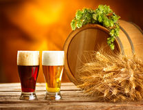 Vintage beer barrel and two glasses. Brewing concept Stock Photos