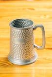 Vintage beer iron mug on table. Metal vintage beer iron mug on table Stock Image