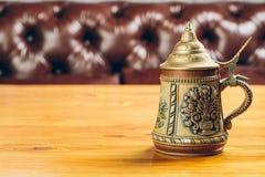 Vintage beer iron mug on table. Metal vintage beer iron mug on table Stock Images