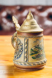 Vintage beer iron mug on table. Metal vintage beer iron mug on table Stock Photography