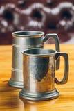 Vintage beer iron mug on table. Metal vintage beer iron mug on table Royalty Free Stock Image