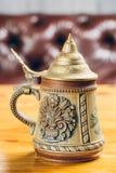Vintage beer iron mug on table. Metal vintage beer iron mug on table Royalty Free Stock Photography