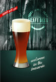 Vintage beer poster with glass of beer. Vector illustration with wooden background. Stock Photos