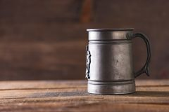 Vintage beer solid iron mug. Vintage beer solid iron drinking mug Stock Photos