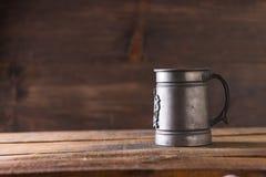 Vintage beer solid iron mug. Vintage beer solid iron drinking mug Royalty Free Stock Images