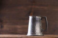 Vintage beer solid iron mug. Vintage beer solid iron drinking mug Royalty Free Stock Image