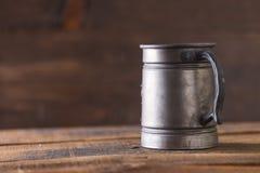 Vintage beer solid iron mug. Vintage beer solid iron drinking mug Royalty Free Stock Photo