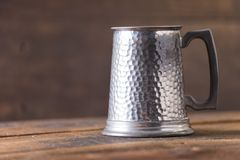 Vintage beer solid iron mug. Vintage beer solid iron drinking mug Stock Photo