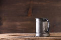 Vintage beer solid iron mug. Vintage beer solid iron drinking mug Stock Photography