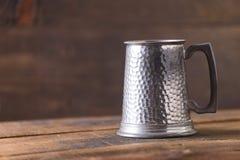 Vintage beer solid iron mug. Vintage beer solid iron drinking mug Stock Image