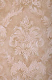Vintage beige wallpaper background Stock Images