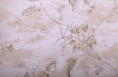 Vintage beige wallpaper with floral pattern. Vintage beige wallpaper with shabby chic floral pattern stock image