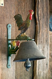 Vintage bell with rooster Stock Photo
