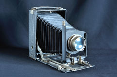 Vintage bellows camera. On black background Royalty Free Stock Photo