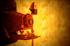 Vintage bellows camera grunge background Royalty Free Stock Photography