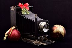 Vintage bellows photo camera and merry Christmas stock photos