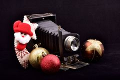 Vintage bellows photo camera and merry Christmas stock image