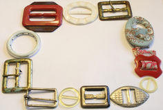 VINTAGE BELT BUCKLES ON OFF WHITE BACKGROUND Royalty Free Stock Photo