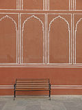 Vintage bench against the india palace wall Royalty Free Stock Photo