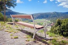 Vintage bench facing mountain view Royalty Free Stock Photos