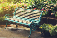 Vintage Bench in flower garden with vintage light filter. Vintage Bench in flower garden with vintage light Royalty Free Stock Photos