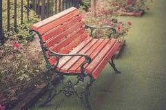 Vintage Bench in garden. Stock Photo