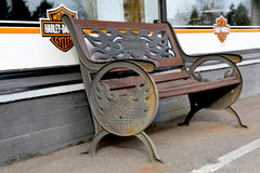 Vintage Bench with Harley-Davidson Signage Stock Photography